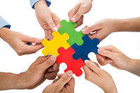 People Hands Connecting Jigsaw Pieces