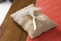 Two wedding rings tied in a sackcloth pad