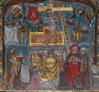 Saint-Omer, bas-relief. Le donateur est représenté agenouillé. Jean-Baptiste lui met la main sur l'épaule