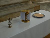 Le pain et le vin pour le repas eucharistique, l'aiguillère
